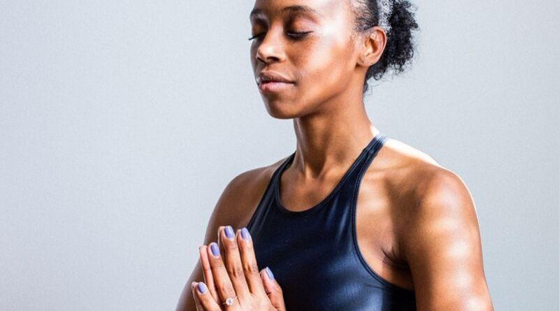 image of black woman practising yoga